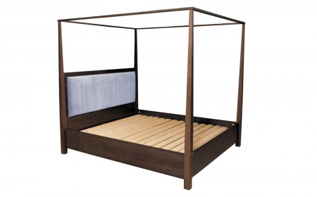 Four poster bed frame with upholstered headboard